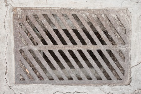 grates: pavement drain Stock Photo