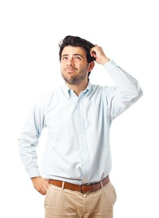 若い男が白い背景の上の頭を悩ま