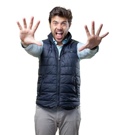 Man with vest stop gesture