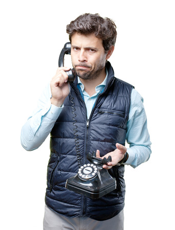 Man with vest speaking on telephone