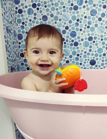 Baby having a bath indoor Foto de archivo