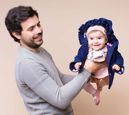 Daddy with baby flying on arms