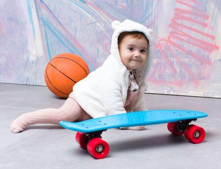 Baby on urban cloths recreation on street