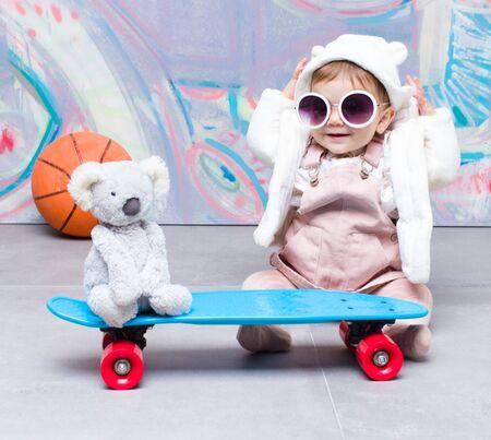 Baby fashion playing on street
