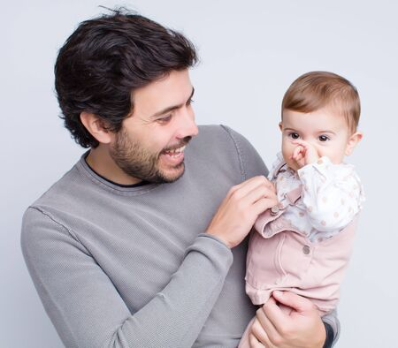 young baby with father over white background