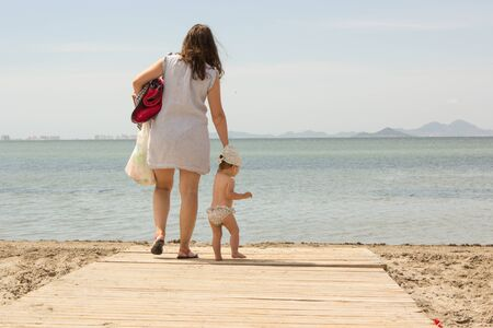 baby with mother in the beach