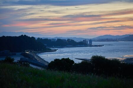 A beautiful sunset over the Pedreña bridge, Santander, Spain