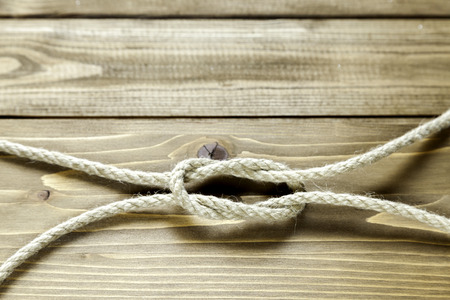 granny knot without  blur on wooden background Stock Photo