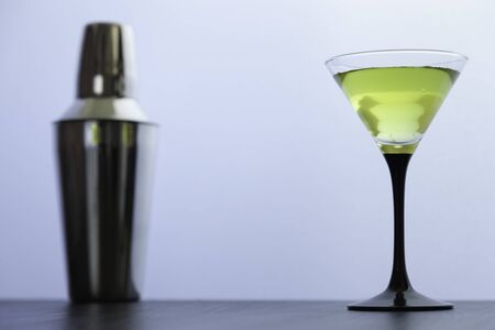 yellow cocktail glass and cocktail shaker on white background Stock Photo