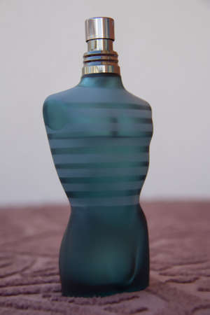 perfume bottle in the shape of a man s body, blue, brown on the table in white background Stock Photo - 17436705