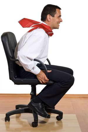 Businessman on an office chair speeding - isolated photo