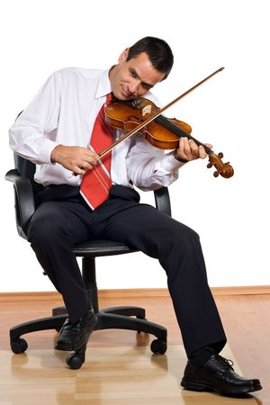Businessman play the violin-isolated  photo