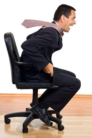 Businessman rolling on an office chair - isolated Stock Photo