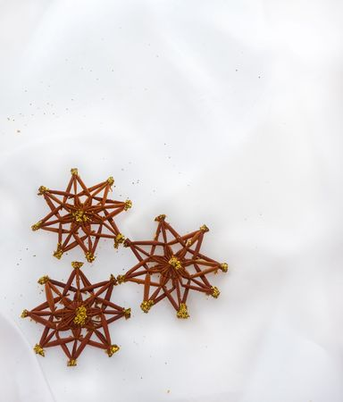 Christmas ornaments on a white silky background Stock Photo