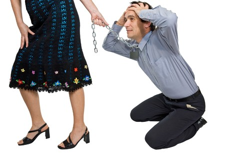 A woman pulling a businessman by a chain locked with padlock photo