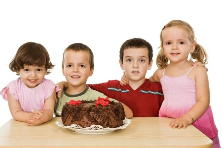 Embracing happy children with cake - isolated photo