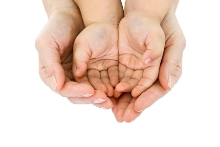 Womans hand hold a childs handful