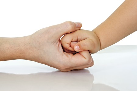 Woman hold her childs hand