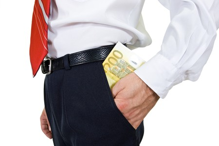 Businessman puting money in the pocket - isolated