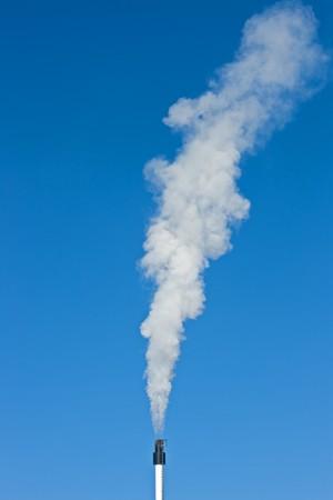 Huge smoke in the sunlight against blue sky