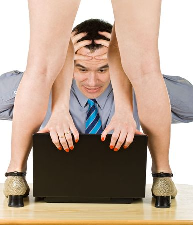 Helpless businessman looking at lost information while an attractive woman close his laptop photo