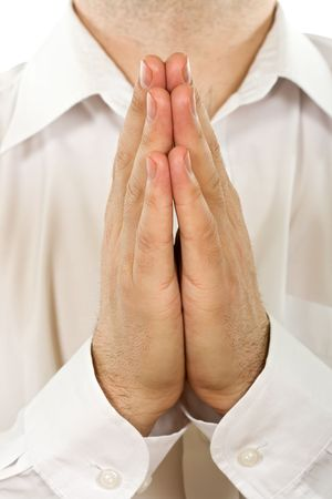 Person is praying, joined clasp his hands Stock Photo