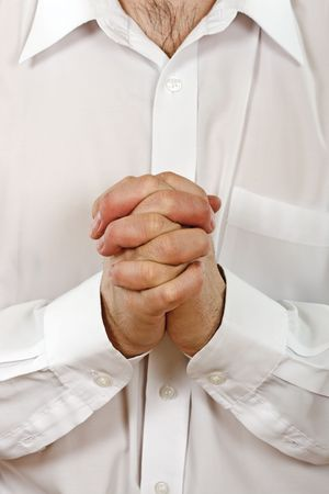 Person is praying, joined clasp his hands Stock Photo - 4679357