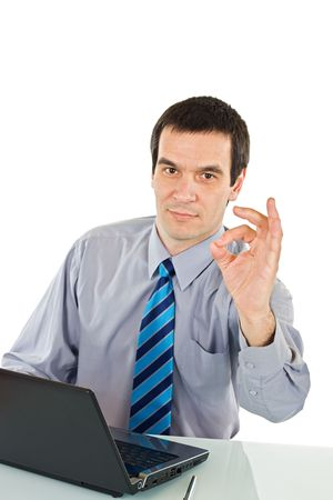 Businessman with laptop showing ok sign - isolated