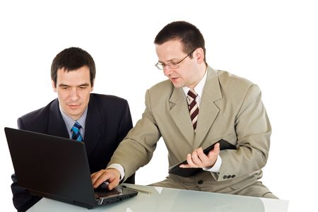 Young businesspeople working on the laptop - isolated
