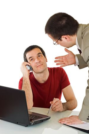 The employee talking by phone with somebody while his boss try to explain him something Stock Photo - 4746862