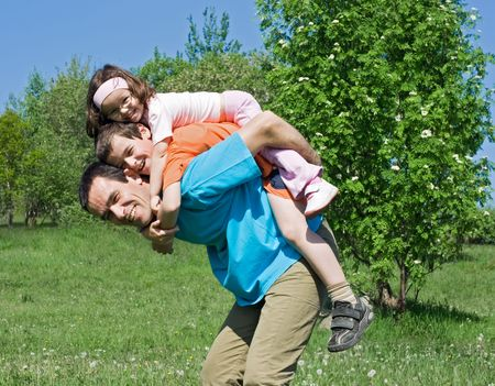 Happy family playing outdoors Stock Photo - 4917888