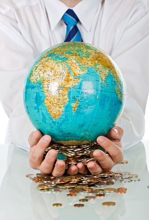 Businessman holding in his hands coins and a globe Stock Photo