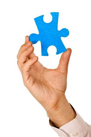 Businessman holding a piece of blue puzzle - isolated