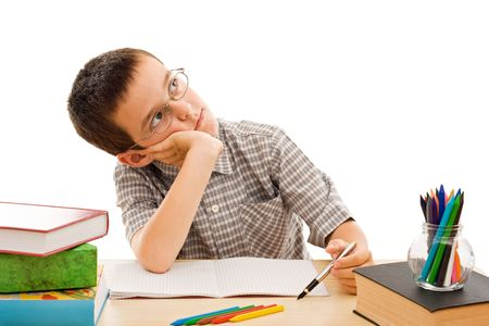 Schoolboy doing bored his homework - isolated Stock Photo