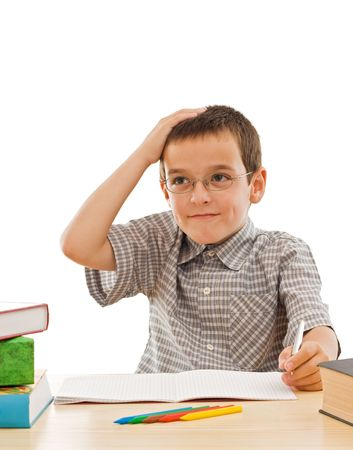 Schoolboy thinking about his homework - isolated