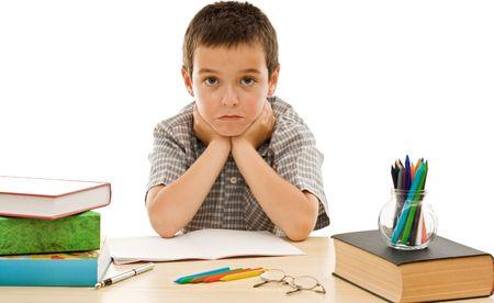 Schoolboy make grimace during the preparation for school