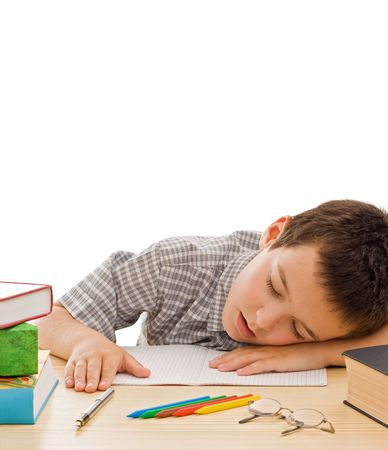 Tired schoolboy sleeping among the books - isolated