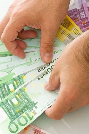Euro banknotes in a mans hand Stock Photo
