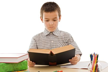 Schoolboy reading an old book - isolated
