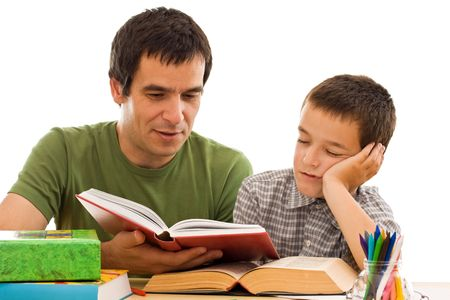 Schoolboy sleeping while his father reading from a red color book - isolated Stock Photo - 5284439