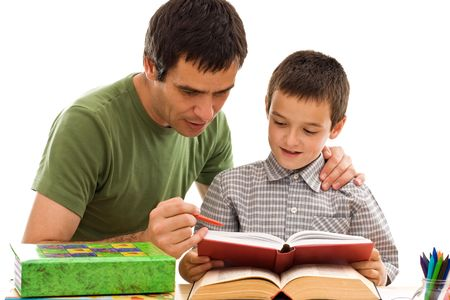 Happy schoolboy and his father learning together - isolated Stock Photo - 5314541