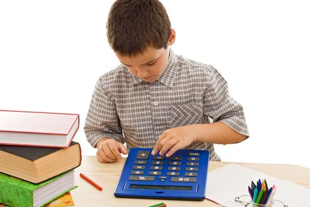 Schoolboy using a calculator for study - isolated