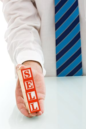 Businessman holding the SELL sign - isolated Stock Photo - 5357555