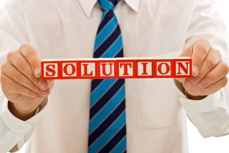 Businessman holding the SOLUTION sign - isolated