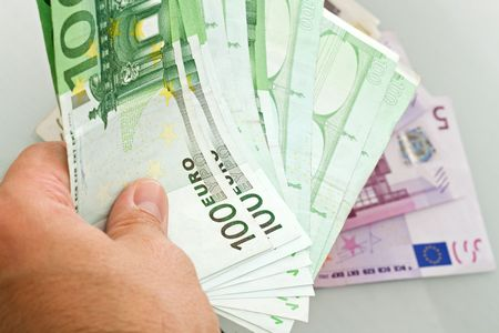 Euro banknotes in a mans hand photo