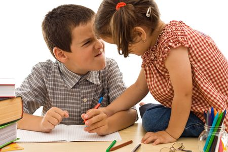 Two children drawing, the boy looks very angry - isolated