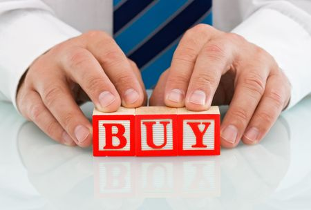 Businessman holding the BUY sign - isolated