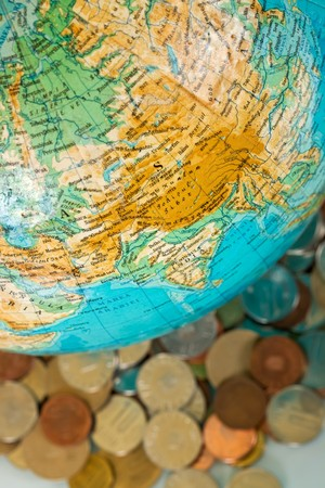 Globe on the pile of money, business concept
