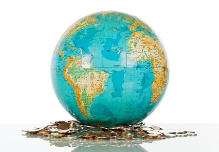Globe on the pile of coins - isolated Stock Photo - 7349933