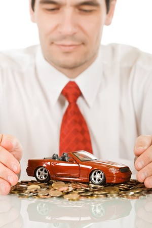 Businessman protecting a red toy car  Stock Photo